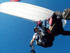tandem skydiving(0.0), wing(0.0), paragliding(1.0), parachute(1.0), air sports(1.0), sports(1.0), parachuting(1.0), windsports(1.0), extreme sport(1.0),