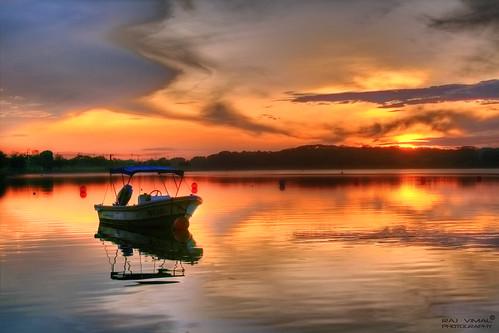 goldstaraward sunrise hdr singapore lowerseletar reservoir rajvimaldev khatib boat calm serene explore interestingness golden paradise water morning sunriseatlowerseletarreservoir raj vimal dev canon cloudy day