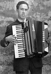 wind instrument(0.0), accordion(1.0), folk instrument(1.0), garmon(1.0), monochrome photography(1.0), monochrome(1.0), black-and-white(1.0), black(1.0),