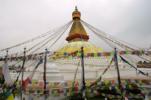 Boudha Stupa, eyes of the Buddha, fresh yellow lotus petal wash, new prayer flags, overcast day, Boudha, Kathmandu, Nepal by Wonderlane