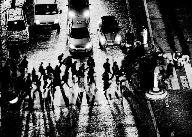 Crossing the Avenue at Night in Paris (high contrast B&W)