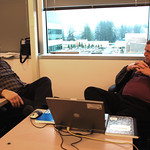 Bill and Howard software team at Redmond, Washington USA, debating how to resolve a technical issue