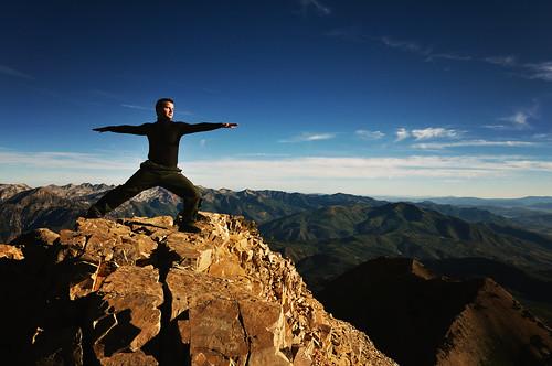 Warrior II pose on mountain top
