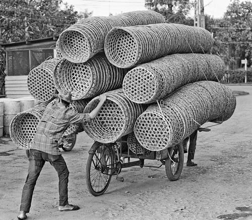 Baskets going to Market, My Tho, Vietnam, in 1968 by Lance & Cromwell