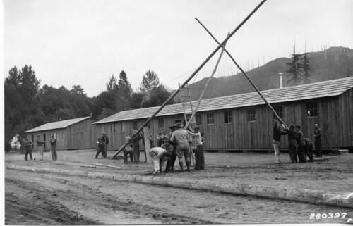 CCC men raising the flag pole at Camp 34 on the lower Cispus River in Washington State