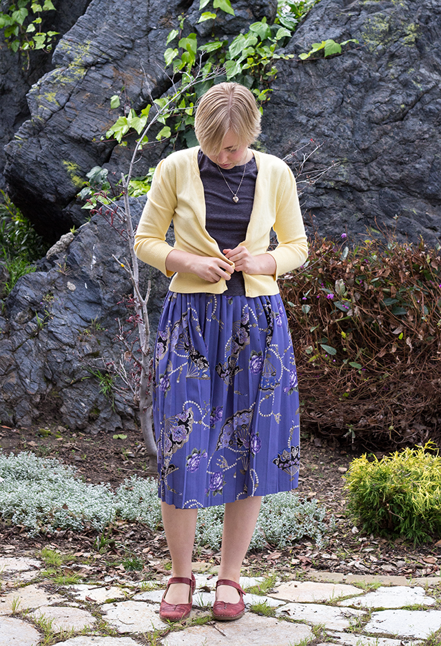yellow cardigan, grey t-shirt, vintage periwinkle pleated skirt