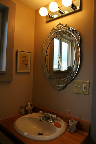 Brown Design	Bathroom photo – Renovation: New 1930's style mirror and mirrored lights, with fresh coat of paper bag brown paint, Seattle, Washington, USA – Brown Design	Bathroom images