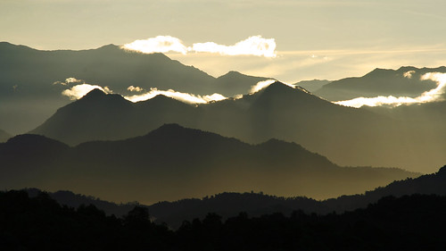 yellow clouds sunrise canon gold lights bravo glow village silhouettes hills rays 70300mm tamron sabah mengkabong 400d