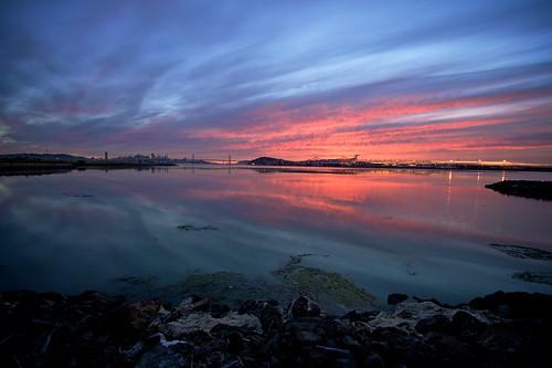 bay baybridge california clouds oakland orange reflection shoreline sky sunset water sanfrancisco unitedstates blogged fav10 fav25 favrtagr:count=10 favrtagr:count=25