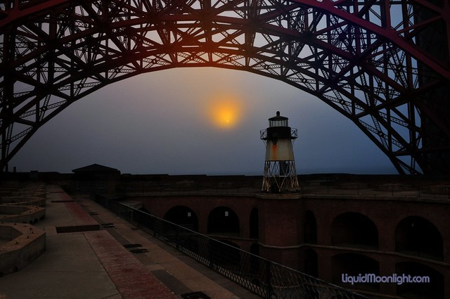 Fort Point Lighthouse At Sunset with Golden Gate Bridge Arch