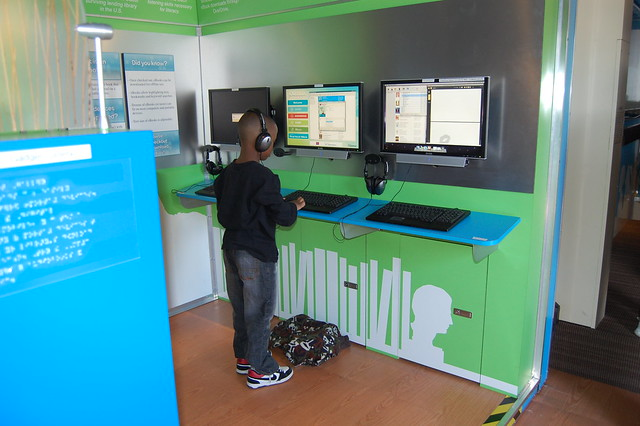 At the computer stations - Genesee District Library - Digital Bookmobile