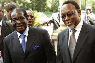 Zimbabwe President Robert Mugabe along with South African Deputy President Kgalema Motlanthe at a regional summit to discuss the situation in the Southern Africa region. by Pan-African News Wire File Photos