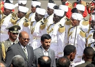 The Presidents of Sudan, Omar Hassan al-Bashir, and Iran, Mahmoud Ahmadinejad, viewing a military formation. Both nations are rich in oil and have been targeted by the United States and Britain for regime change. by Pan-African News Wire File Photos