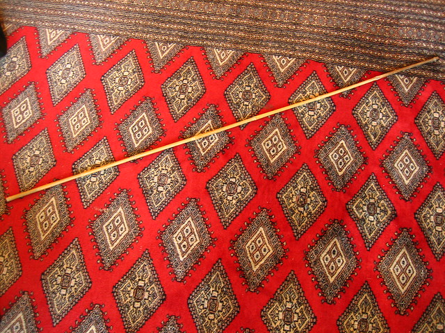 Bamboo pole on carpet #3