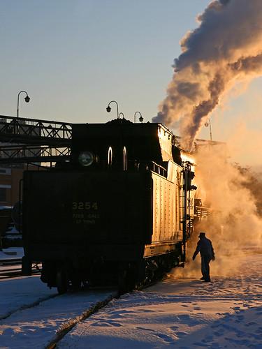 shadow snow silhouette sunrise pennsylvania steam locomotive scranton railyard steamtown