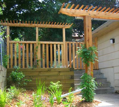 Custom fence and japanese style pergola with rain garden for Custom garden designs