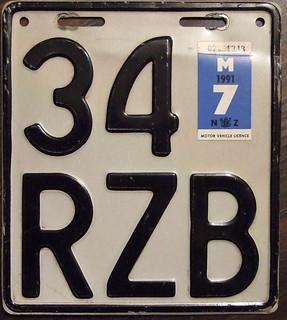 NEW ZEALAND 1991 Motorcycle plate WHITE base