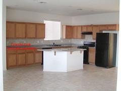 living room(0.0), floor(1.0), kitchen(1.0), furniture(1.0), countertop(1.0), wood(1.0), room(1.0), property(1.0), interior design(1.0), hardwood(1.0), cabinetry(1.0), flooring(1.0),
