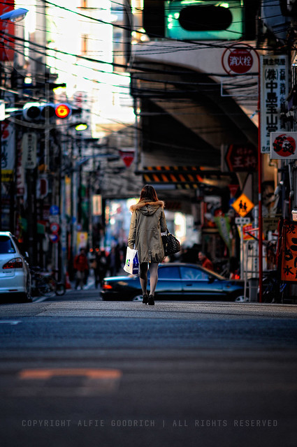 Japanese girl walking home from the shops; Asakusabashi, Tokyo
