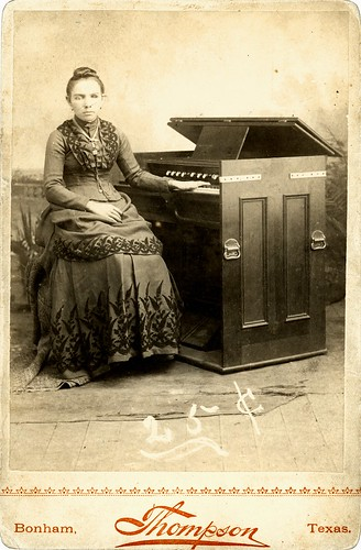 Girl sitting at organ, Bonham Texas w