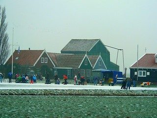 Skating on a frozen canal in Marken