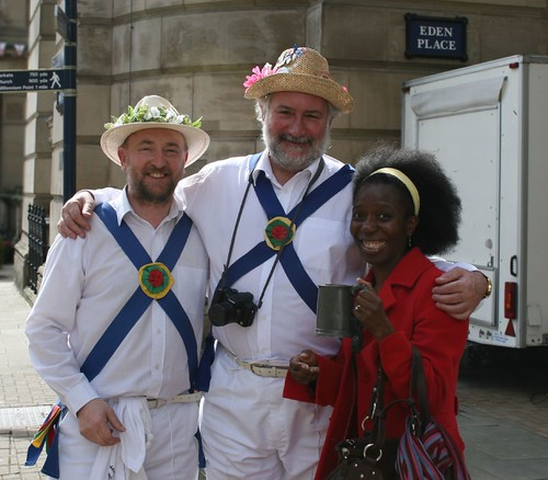 Morris men with a lady in a red coat