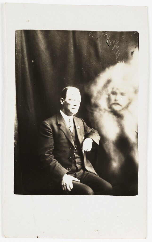 Man with a spirit face appearing