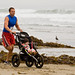 Man running while pushing a baby trike - Runners at 1st Annual Rock 2 Rock 5 Mile Fun Run