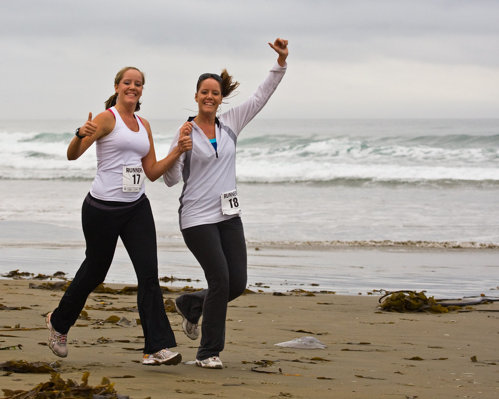 1 of 2 Two delightful girls give thumbs up - Runners at 1st Annual Rock 2 Rock 5 Mile Fun Run