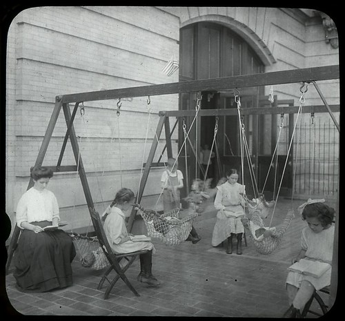 Children reading on the playground, 1910. Photo via NYPL's archive.