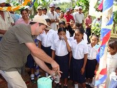DSC02953 Thierry Sciari of Res Publica pouring the first glasses of water for girls of the village