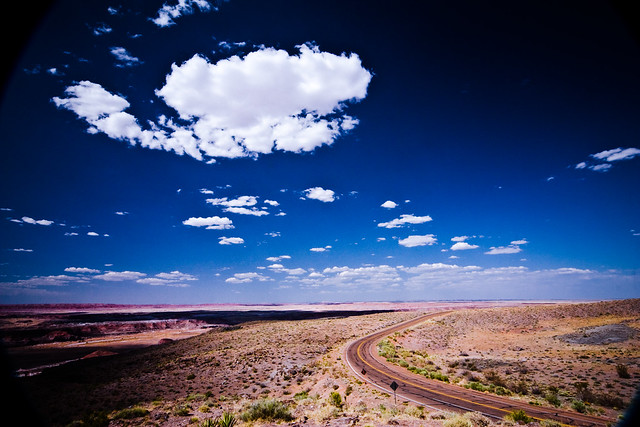 clouds over an Arizona road