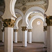 Small photo of Repeating arches and carved plaster