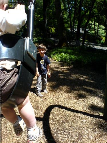 nick helping sequoia on the swings   DSC00893