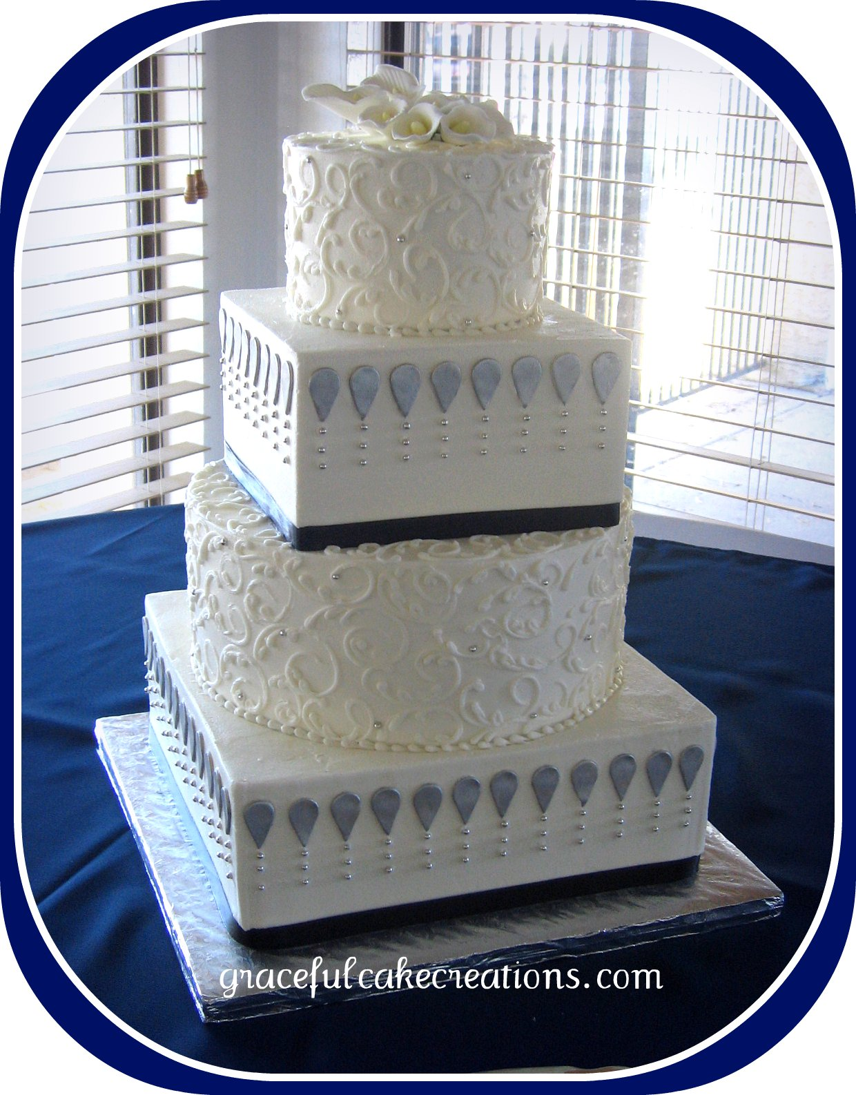 White Silver and Navy Blue Wedding cake