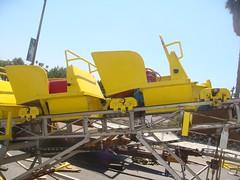 vehicle(0.0), construction equipment(0.0), bulldozer(0.0), harvester(0.0), asphalt(1.0), machine(1.0),