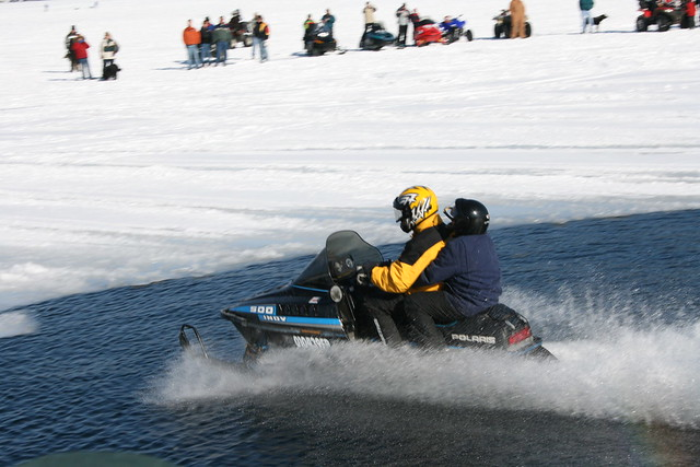 Snowmobiles Skipping Water 34
