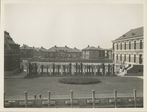 View of Ellis Island buildings, with garden and trellises in...