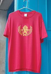 neck(0.0), blouse(0.0), pocket(0.0), pink(0.0), active shirt(1.0), magenta(1.0), clothing(1.0), red(1.0), sleeve(1.0), font(1.0), shirt(1.0), t-shirt(1.0),
