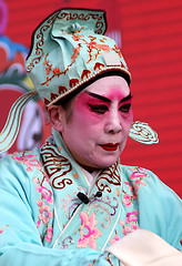 clothing(1.0), tradition(1.0), female(1.0), peking opera(1.0), costume(1.0), person(1.0), pink(1.0),