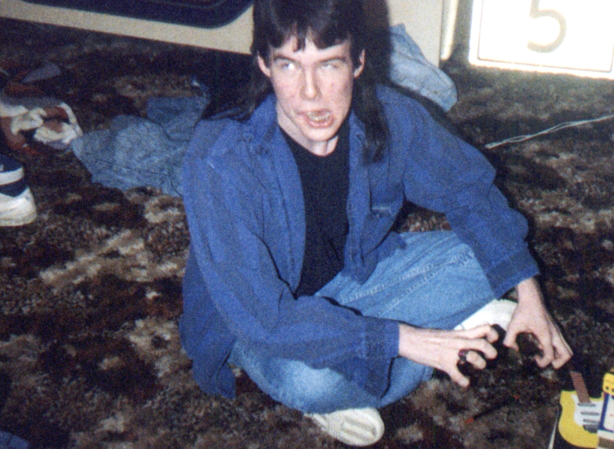 1991ish - Clint's room - Brent - trying to be evil - sitting - 0451