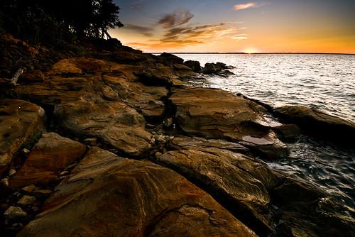 sunset sky water rocks texas unitedstates greenvalley lakerayroberts pilotpoint