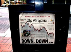 Oregonian newspaper: falling graph and headline 'DOWN, DOWN ...'
