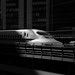 Business end of a N700 bullet train disappearing into the shadows