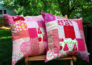 two pink patchwork pillows