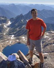 walking(0.0), sports(0.0), mountaineering(0.0), extreme sport(0.0), climbing(0.0), hiking(0.0), adventure(1.0), mountain(1.0), recreation(1.0), outdoor recreation(1.0), mountain range(1.0), summit(1.0), ridge(1.0), mountain guide(1.0), mountainous landforms(1.0),