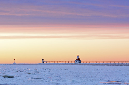 winter sunset lighthouse lake snow ice beach michigan stjoseph