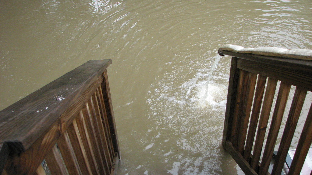 Back Yard-Water Pumping out of Basement into Flood