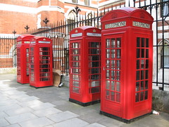 Four red phone boxes London