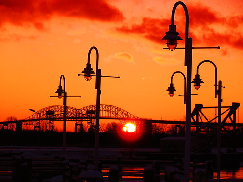 city bridge light sunset red orange sunlight ontario canada colour beautiful america canon river fantastic waterfront unitedstates bright michigan sunsets powershot boardwalk recreation colourful 1001nights saultstemarie northernontario lampposts algoma internationalbridge chippewacounty sx110 platinumheartaward colourfullaward colorsinourworld thebillster23